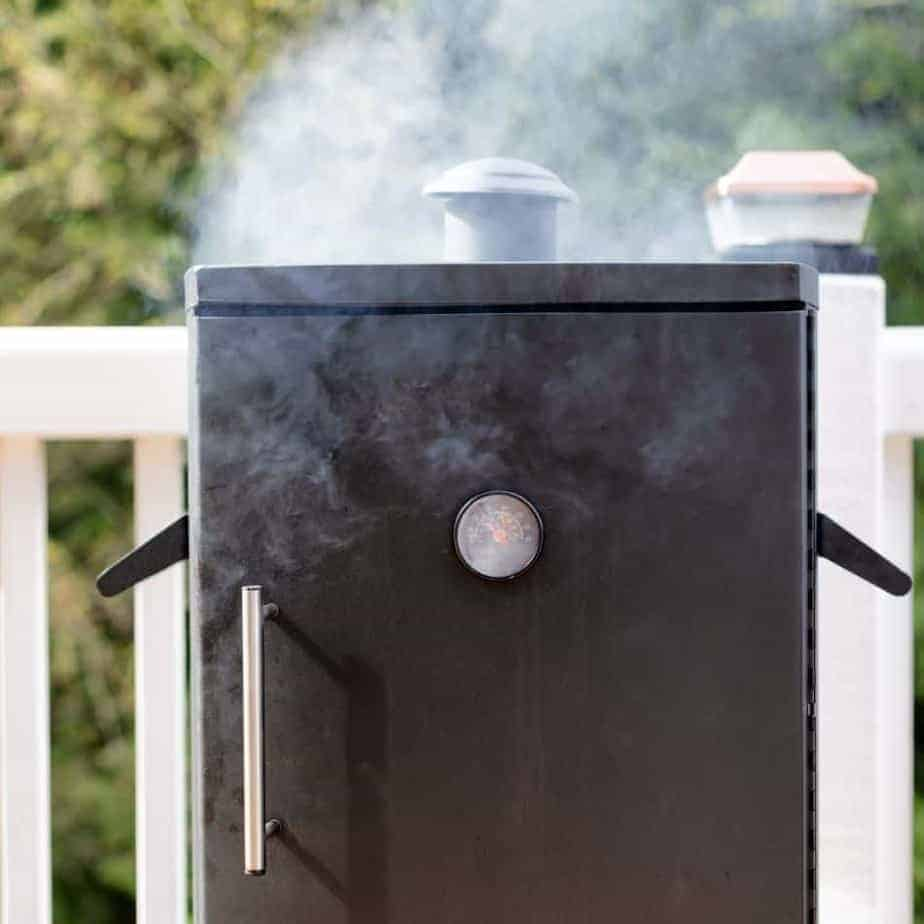 Vertical cabinet barbecue smoker
